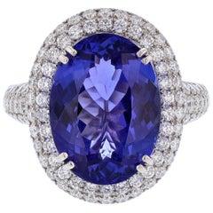 18 Karat White Gold 7.62 Carat Oval Tanzanite and Diamond Ring