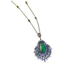 18 Karat White Gold 8.37 Karat Emerald 165 0.0096 Karat Diamond Pendant