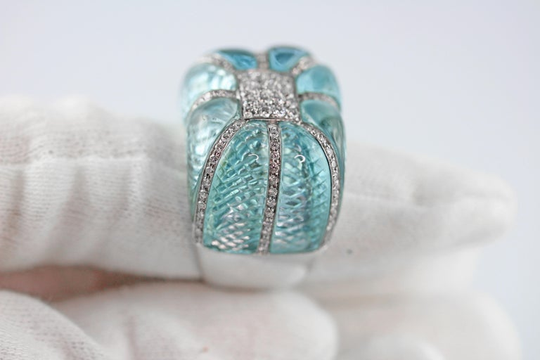 Acquamarine and white diamond ring, the external surface is smooth and rounded, and it has been carved inside to recreate a knurled effect.  US Size: 7.5 Weight: 26 gr circa  The finger size of our rings can be adjusted and our workshop will be