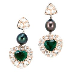 18 Karat White Gold All Seeing Eye Earring with 6.4 Carat Heart Shaped Emeralds