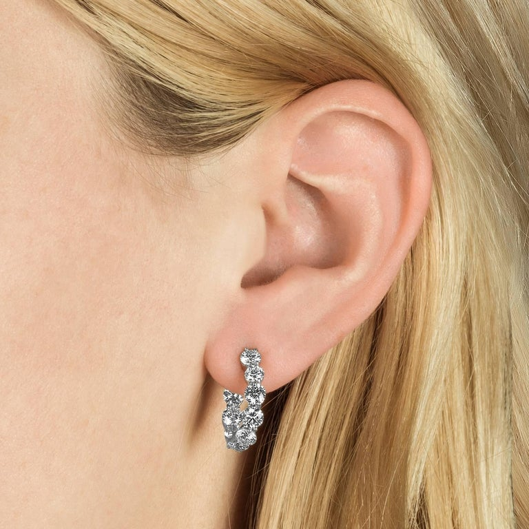 Shah & Shah's 18k white gold and diamond curved hoop earrings. These feature 18 H/SI1 round brilliant cut diamonds that total 4.15 carats and locking backs.  Complimentary appraisal is included in your purchase.
