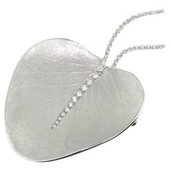 18 Karat White Gold and Diamond Eucalyptus Leaf Pendant and Brooch