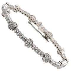 18 Karat White Gold and Diamond Flower Cluster Tennis Bracelet 4.5 Carat