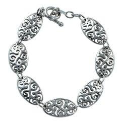 18 Karat White Gold and Diamond Swirl and Swag Bracelet