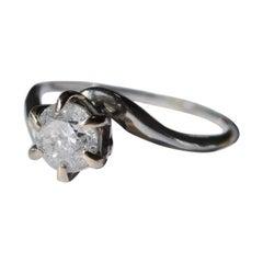 18 Karat White Gold and Diamond Swirl Ring