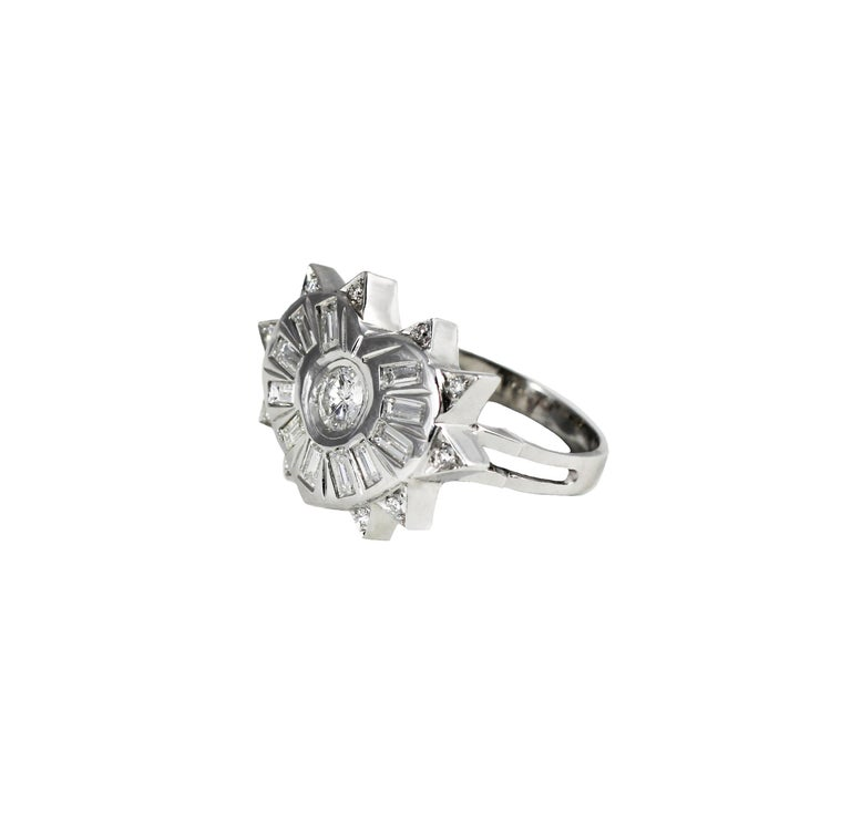 """This fashion heart shape ring is called """"Fearless Heart"""". The designers took inspiration on the concept of True Love. The heart's spikes represent diamond's hardness that break all the prejudices that constrain true love;  the baguette-cut diamonds"""