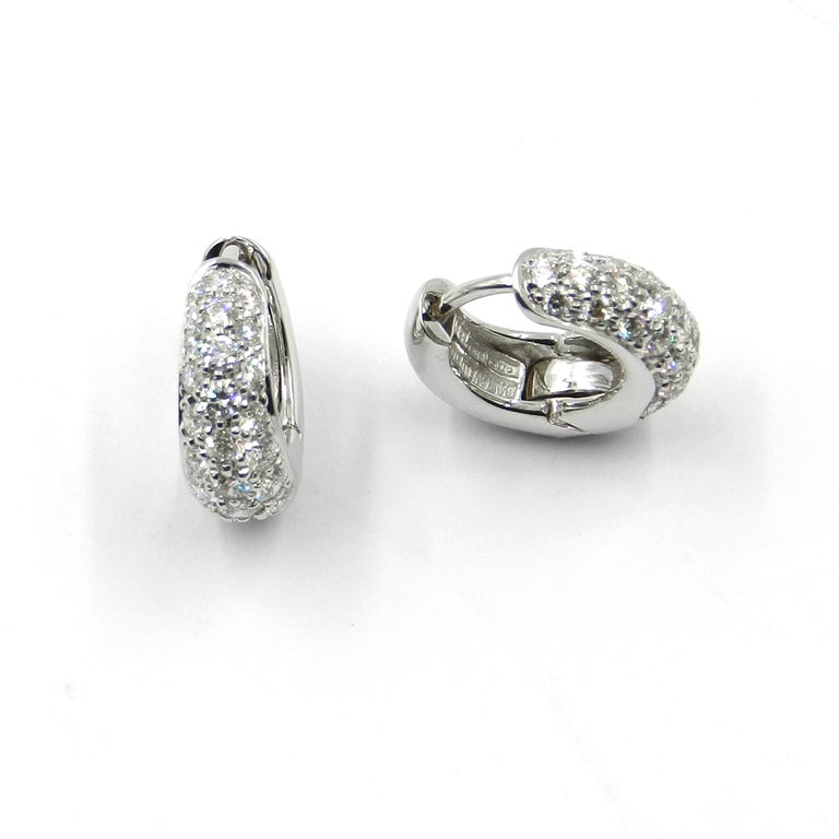 3f5f850414204 18 Karat White Gold and Pavè Diamond Garavelli Huggie Earrings