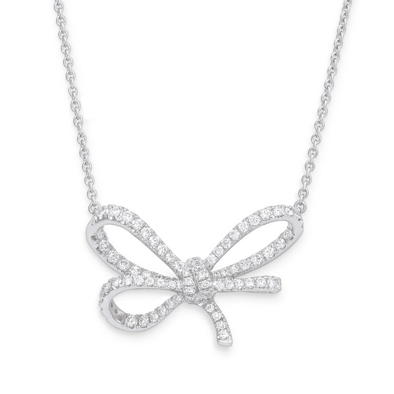 Round Cut 18 Karat White Gold and White Diamonds Bow Bracelet, Pendant and Ring For Sale