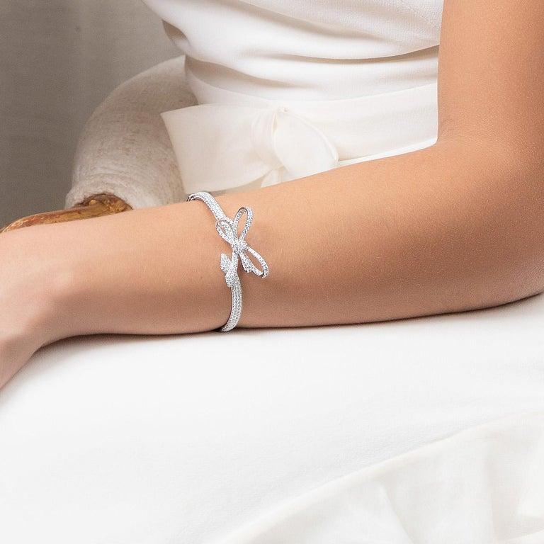 Women's 18 Karat White Gold and White Diamonds Bow Bracelet, Pendant and Ring For Sale