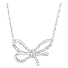 18 Karat White Gold and White Diamonds Bow Pendant