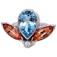18 Karat White Gold Aquamarine and Precious Topaz Ring with a White Diamond