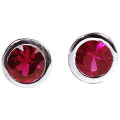 18 Karat White Gold Bezel Set Ruby Stud Earrings