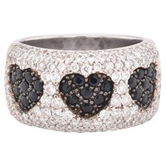 18 Karat White Gold Black and White Diamond Three-Heart Cigar Band