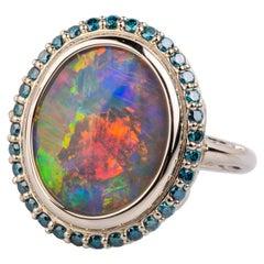 18 Karat White Gold Black Opal Ring with Teal Blue Diamond Halo