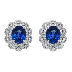 18 Karat White Gold Blue Oval Sapphire Earrings
