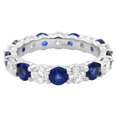 18 Karat White Gold Blue Sapphire and Diamond Eternity Band