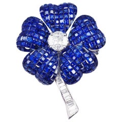 18 Karat White Gold Blue Sapphire Diamond Invisible Flower Brooch
