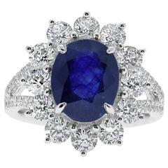 18 Karat White Gold Blue Sapphire Ring Set with Brilliant Cut Diamonds