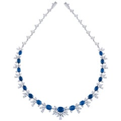 18 Karat White Gold Blue Sapphire White Diamond Necklace and Earrings
