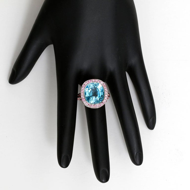 18K White Gold Blue Topaz and Pink Sapphire Ring  - This is a stunning cocktail ring that has a cushion shaped blue topaz that measures 13.75x12.50x9 mm. Topaz is approx 12.75 carats. Round cuts of pink sapphire was added to complete this ring, they