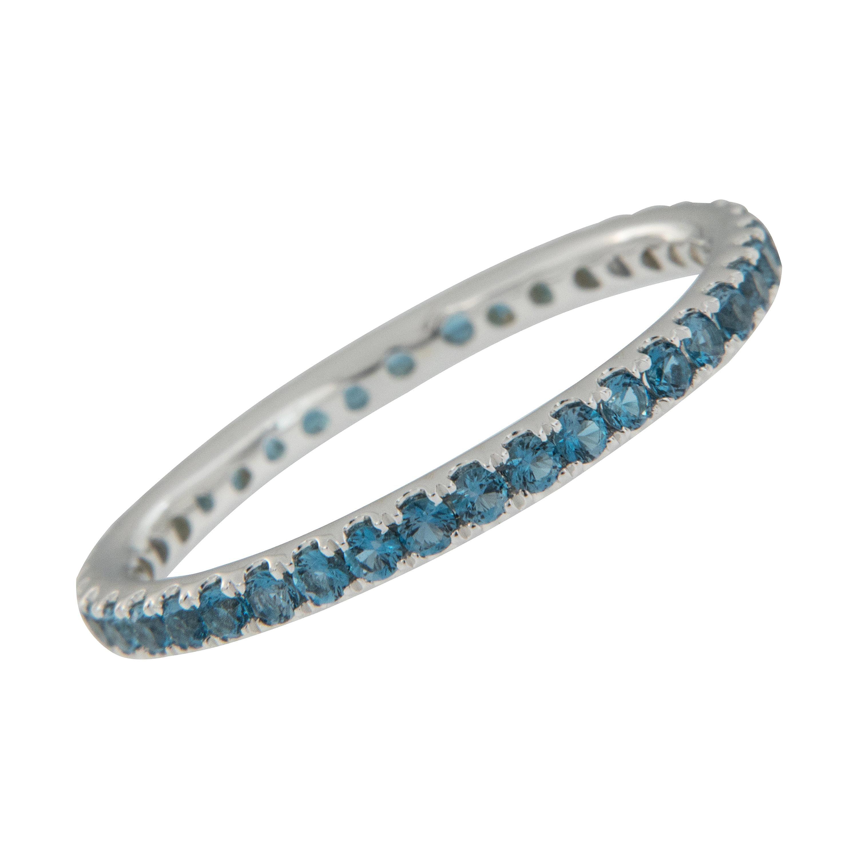 18 Karat White Gold Blue Topaz Eternity Ring
