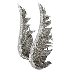 18 Karat White Gold Brooch of Carved Wings with Encrusted Diamonds