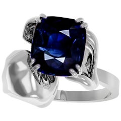 18 Karat White Gold Contemporary Bridal Ring with 1.75 Carat Cushion Sapphire