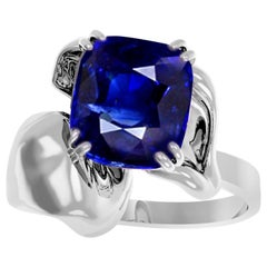 18 Karat White Gold Contemporary Engagement Ring with 2.2 Carat Cushion Sapphire
