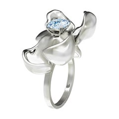 18 Karat White Gold Contemporary Engagement Ring with Light Blue Sapphire