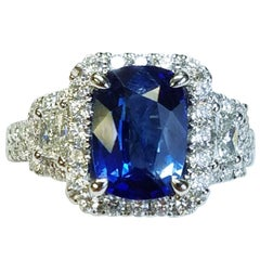 18 Karat White Gold Cushion Cut Sapphire and Diamond Ring