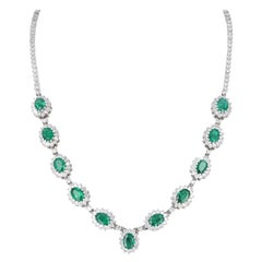 18 Karat White Gold 6.84ct Diamond and 11ct Emerald Drop Necklace. 16 inches