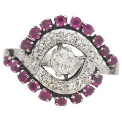 18 Karat White Gold Diamond and Ruby Bypass Ring, Round Brilliant Cut Center