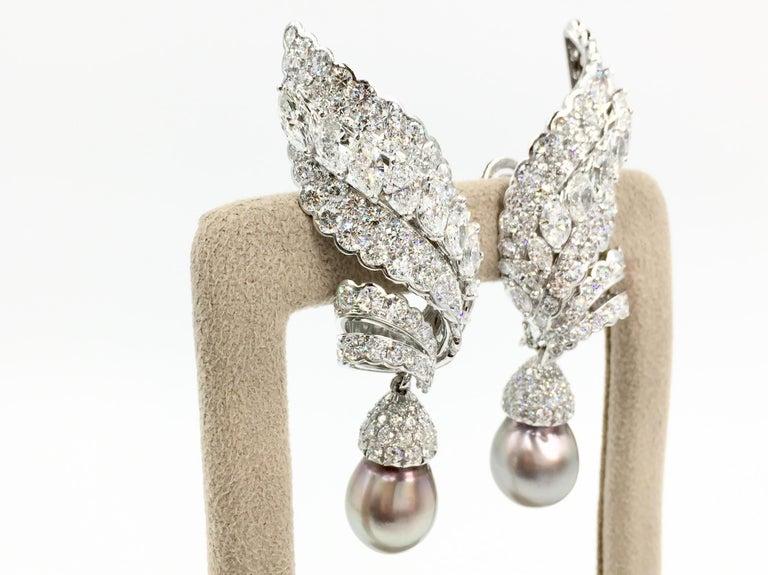 Modern 18 Karat White Gold Diamond and Tahitian Pearl Swirl Climber Earrings For Sale