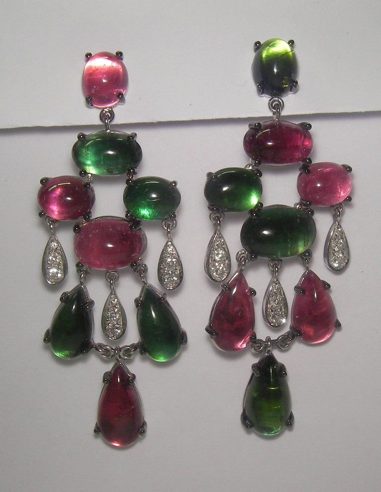 18 Karat White Gold Diamond  and Tourmaline  Dangle Earrings  18 Diamonds 0,71 Carat 16 Tourmaline  rose and green 49,45 Carat       Founded in 1974, Gianni Lazzaro is a family-owned jewelery company based out of Düsseldorf, Germany. Although rooted