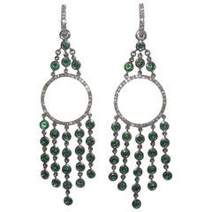 18 Karat White Gold Diamond and Tsavorite Dangle Earrings it