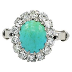 18 Karat White Gold Diamond and Turquoise Halo Cocktail Ring