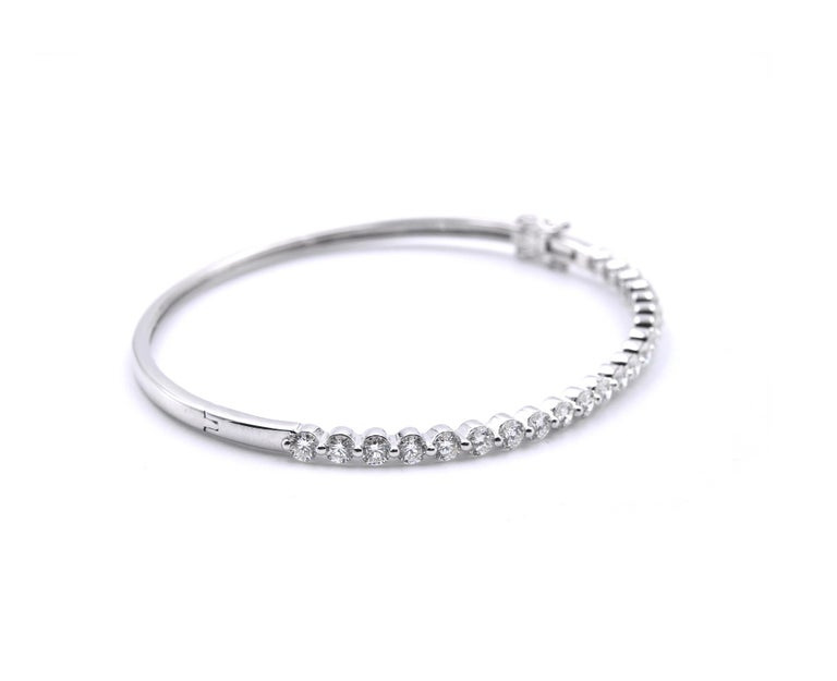 Material: 18K White Gold Diamonds:  22 Round brilliant cuts = 2.20cttw Color: G Clarity: VS Dimensions: bracelet measures 6.5-inches in length Weight: 5.90grams