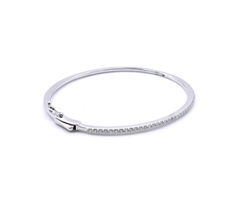 Material: 18K white gold Diamonds: 46 Round Brilliant Cuts = .72cttw Color: G Clarity: VS Dimensions: bracelet will fit up to a 6.5-inch wrist Weight: 9.87 grams