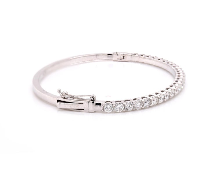 Material: 18K white gold Diamonds:  26 round cut = 2.83cttw Color: G Clarity: VS Dimensions: bracelet will fit up to a 6.5-inch wrist  Weight: 15.21 grams