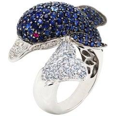 18 Karat White Gold Diamond Blue White Sapphire Dolphin Bypass Ring