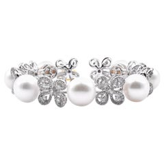 18 Karat White Gold Diamond Butterfly Pearl Bangle Bracelet