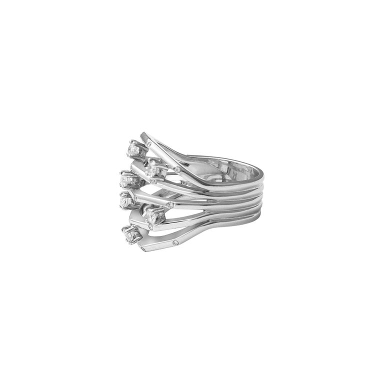18 Karat White Gold Diamond Cocktail Ring  This unique design, expertly crafted is ideal for an evening out. Set on 18 karat white gold and studded with 0.60ct round diamonds, this ring is sure to grab attention.  Diamonds - 0.60cts 18 Karat Gold -