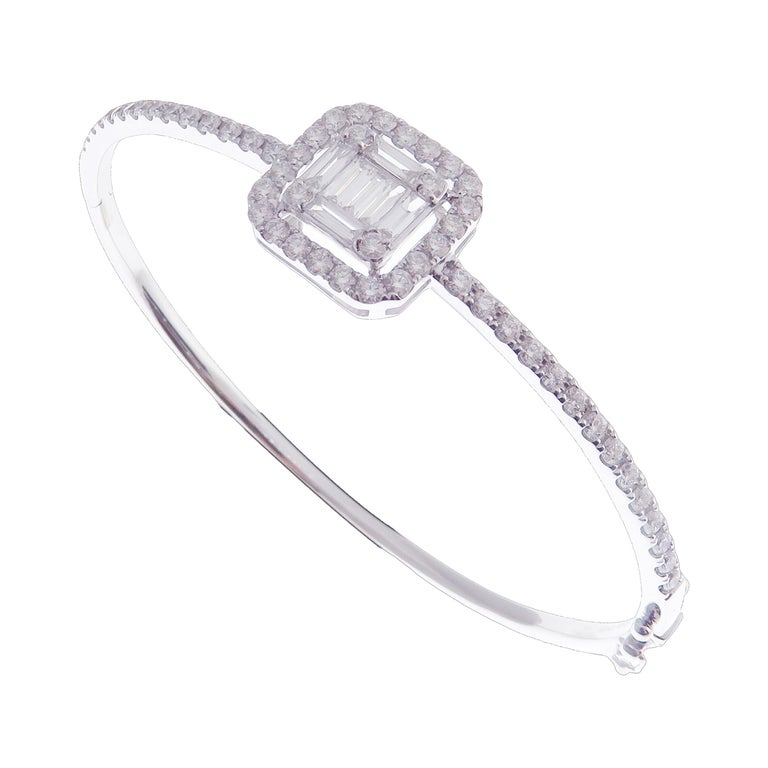 This delicate baguette square bangle is crafted in 18-karat white gold, weighing approximately 1.72 total carats of V-Quality white diamond. Side clasp closure.   Fits wrists up to 6.25