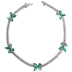 18 Karat White Gold Diamond Emerald Butterfly Tennis Bracelet