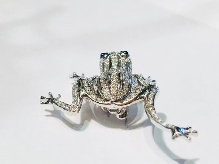 Round Cut 18 Karat White Gold Diamond Frog with Sapphire Cabochon Eyes Moving Limbs Brooch For Sale