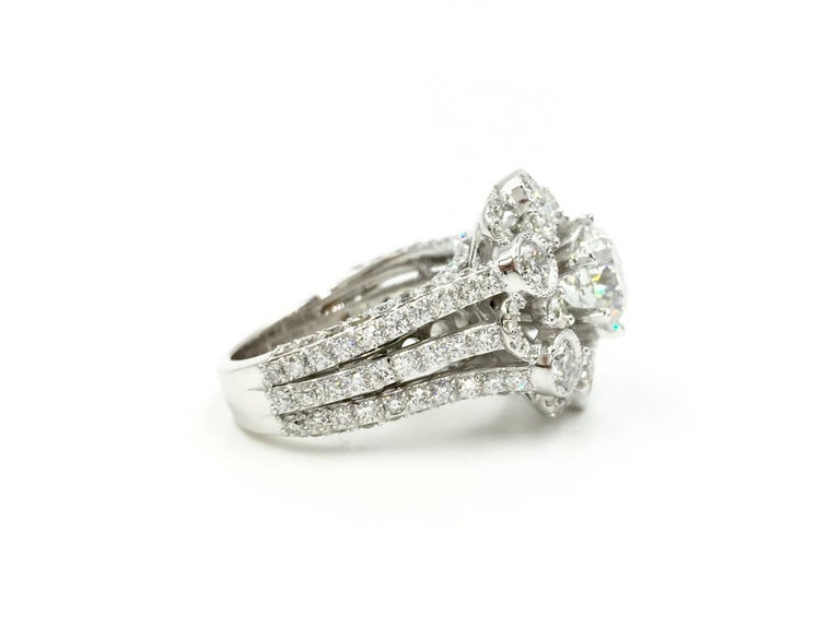 Looking for a unique diamond statement ring with a big look? Look no further! This stunning 18k white gold ring with a total diamond weight of 3.67 carats features a 1.59 carat round brilliant cut diamond in the center set beautifully with 6 prongs.