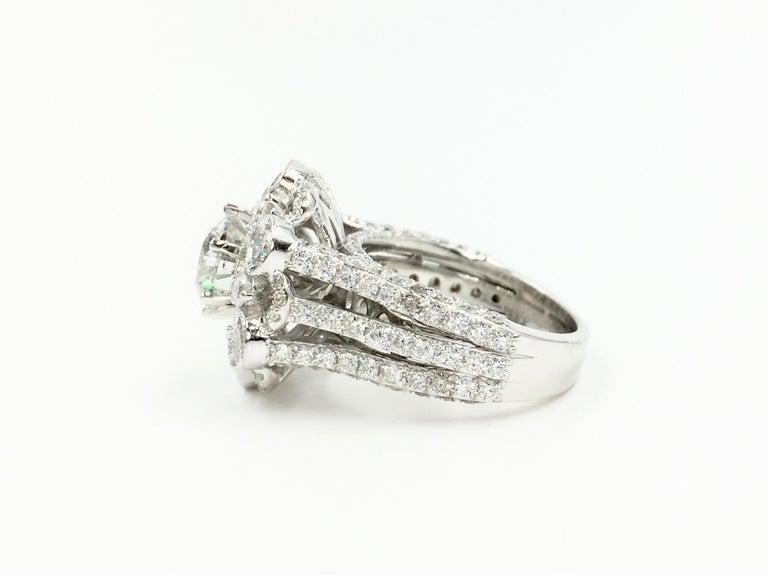 Modern 18 Karat White Gold Diamond Halo Style Ring 3.67 Carat Total Weight For Sale