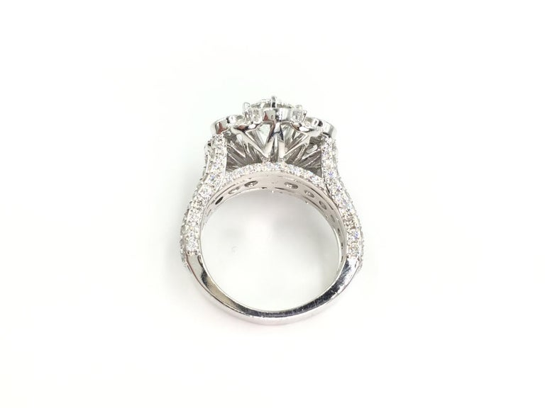 Round Cut 18 Karat White Gold Diamond Halo Style Ring 3.67 Carat Total Weight For Sale