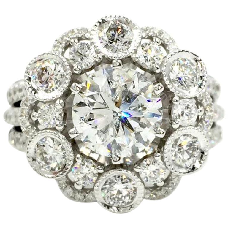 18 Karat White Gold Diamond Halo Style Ring 3.67 Carat Total Weight For Sale