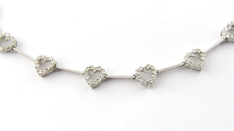 Vintage 18 Karat White Gold Diamond Heart Necklace-  This exquisite necklace features 11 sparkling hearts (8 mm x 8 mm) each decorated with 12 round brilliant cut diamonds and set on a stunning beaded 18K white gold necklace.  Approximate total